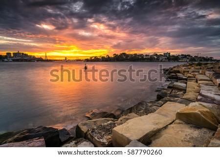 Dramatic Sunset at Barangaroo Reserve, Sydney Royalty-Free Stock Photo #587790260