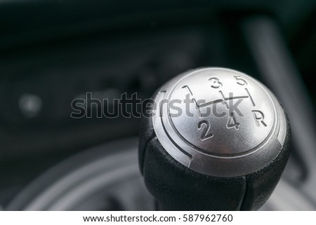 Abstract view of a gear lever, manual gearbox, car interior details #587962760