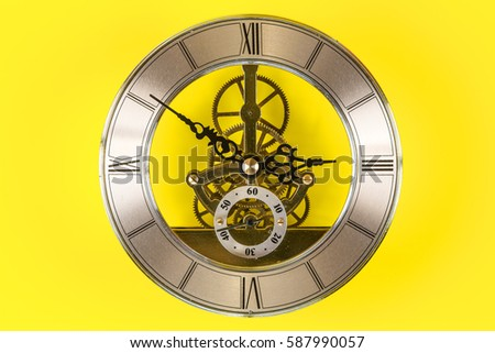 Vintage bronze clock isolated on a yellow background #587990057