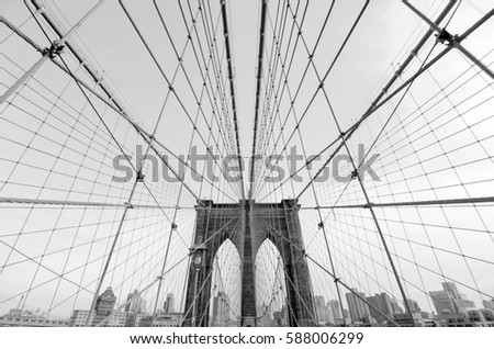 Perfect geometry of the Brooklyn Bridge cable web with overlook on Manhattan black and white monochrome modern but retro looking photo