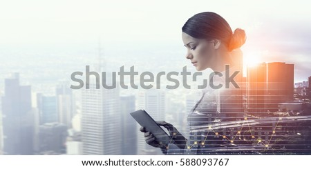 Attractive business lady working on tablet    . Mixed media Royalty-Free Stock Photo #588093767