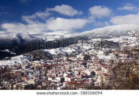 Panoramic view of the city of Karpenisi, in Evritania region, in central Greece. It is in the middle of the winter, with snow everywhere and quite cold atmosphere. #588106094