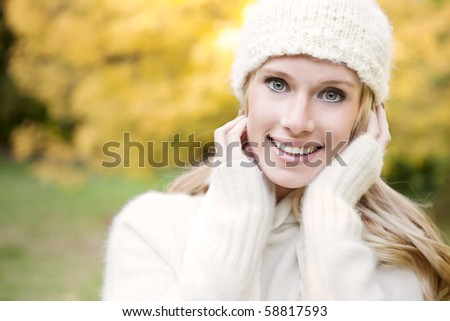 A portrait of a beautiful autumn woman outdoor #58817593