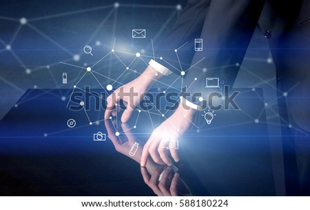 Male hands touching interactive table with blue mixed communication icons in the background #588180224