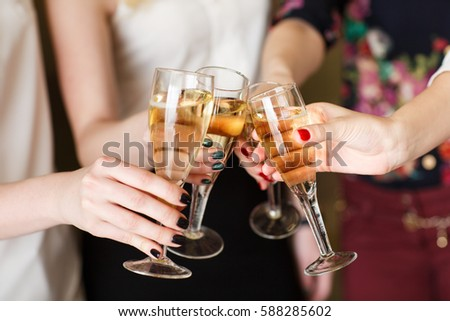 Hands holding the glasses of champagne making a toast #588285602