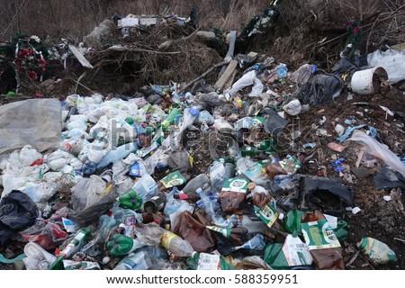 Transcarpathia, Ukraine - February 26, 2017: Contamination of the environment by humans. Garbage dump. #588359951