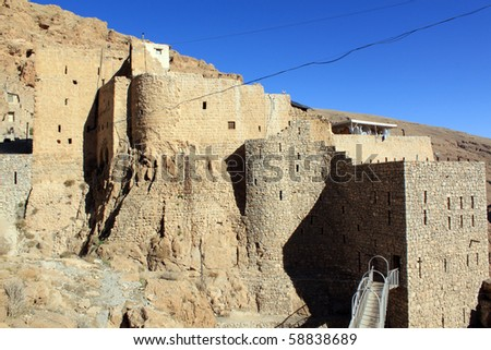 Stone walls of monastery Mar Musa in Syria #58838689
