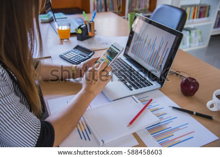 business man hand working on smart phone and laptop computer and #588458603