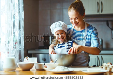 happy family in the kitchen. mother and  child daughter preparing the dough, bake cookies #588502532