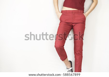Woman in red pants and shirt #588567899