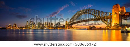 Sydney. Panoramic image of Sydney, Australia with Harbour Bridge during twilight blue hour. Royalty-Free Stock Photo #588635372