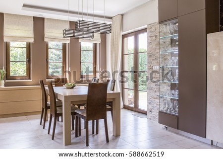Picture of elegant beige dining room design Royalty-Free Stock Photo #588662519