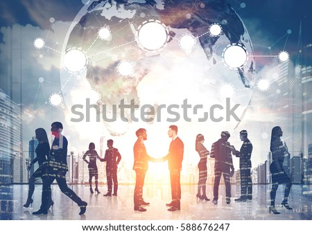 Silhouettes of business people shaking hands and walking against a morning cityscape. There is a world map and a network.  Elements of this image furnished by NASA. Toned image. Double exposure. #588676247