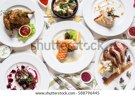 Fish and meat meals variety flat lay. Top view on buffet with assortment of healthy hearty food. Buffet, banquet, appetizer, restaurant menu concept #588796445