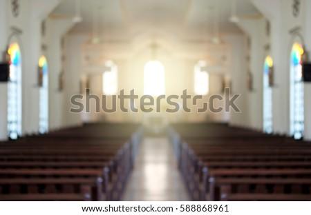 Blurred background of a surreal illuminated church aisle.