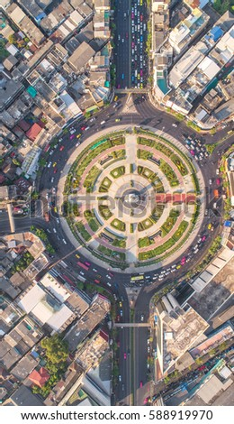 Road roundabout with car lots Wongwian Yai in Bangkok,Thailand. street large beautiful downtown at evening light.  Aerial view , Top view ,cityscape ,Rush hour traffic jam #588919970