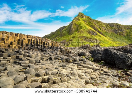 Giant's Causeway in a beautiful summer day, Northern Ireland Royalty-Free Stock Photo #588941744