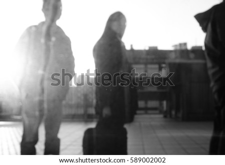 Black and White people in bokeh,blur look pass train window #589002002