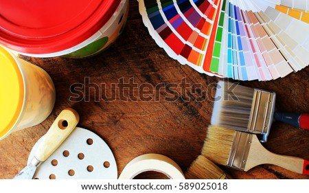 various painting tools and color palette on wooden background #589025018