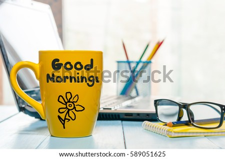 Good morning message on coffee cup at workplace background #589051625