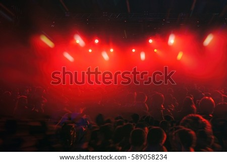 MOSCOW-2 FEBRUARY,2015:Bright red stage lighting on concert in music hall.Techno club party background.Edm dj music festival background.Concert crowd rave on dance floor.People dance on edm music fest #589058234