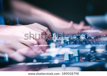 MOSCOW - 7 AUGUST,2016: Dj play music at hip hop party.Turntable vinyl record player,analog sound technology for disc jockey to scratch vinyl records,mix tracks.Dj scratching record on the show #589058798