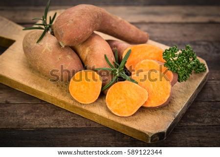 Raw sweet potatoes #589122344