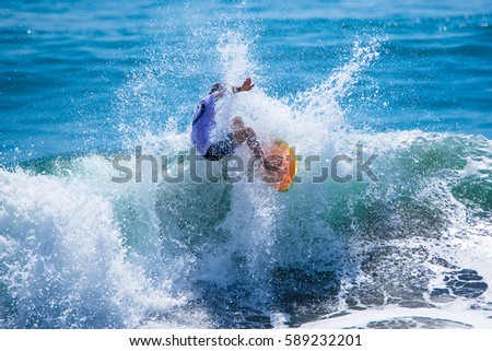 Riding the waves. Costa Rica, surfing paradise #589232201