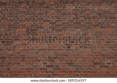 Old brick wall, old texture of red stone blocks closeup #589316597