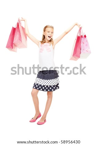 happy girl with shopping bags over white #58956430