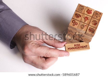 Business, Technology, Internet and network concept. Young businessman shows the word: Risk management #589601687