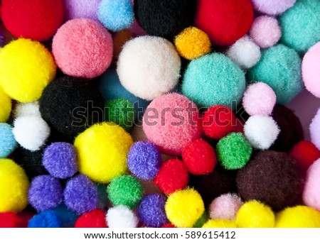 colored pompoms of different sizes, creative materials #589615412