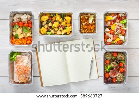 Diet plan mockup with healthy restaurant food delivery. Natural organic fitness nutrition for diet. Daily meals in foil boxes with copy space at white wood. Top view, flat lay #589663727