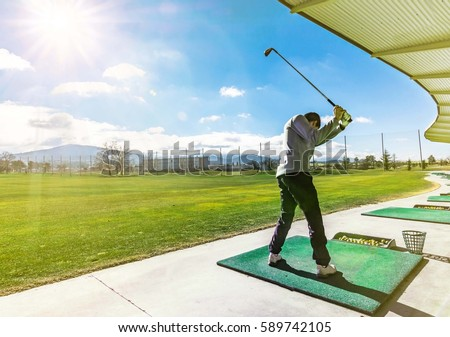 Driving Range Golf Royalty-Free Stock Photo #589742105