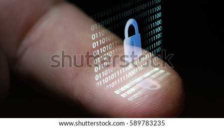 Macro shot of fingerprint leaning on control glass for biometric scan. concept of surveillance and security through human fingerprints #589783235