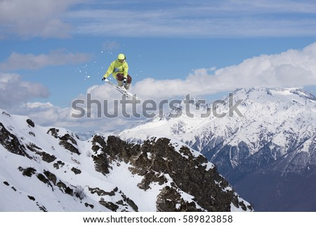 Skier jump on mountains. Extreme sport. #589823858