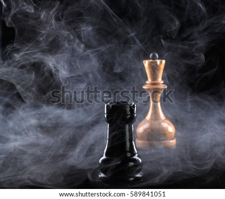 Two chess pieces in fog on black background #589841051