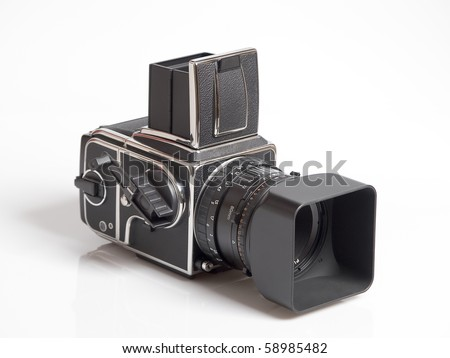 The photo shows a medium format camera over white