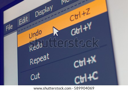 Software menu item with undo command highlighted and mouse cursor selected it, macro shot #589904069