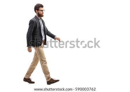 Full length profile shot of a young bearded man walking isolated on white background #590003762