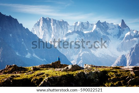 Views of the Mont Blanc glacier with Lac Blanc (White Lake). Popular tourist attraction. Picturesque and gorgeous scene. Location place Nature Reserve Aiguilles Rouges, Graian Alps, France, Europe. #590022521