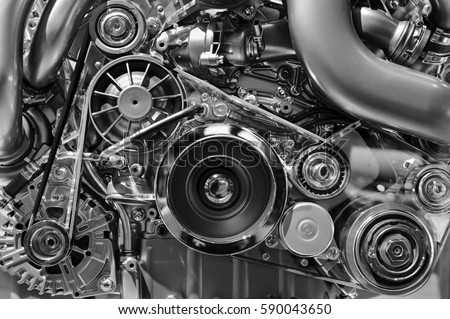 Car engine, concept of modern vehicle motor with metal, chrome, plastic parts, heavy industry, monochrome  Royalty-Free Stock Photo #590043650