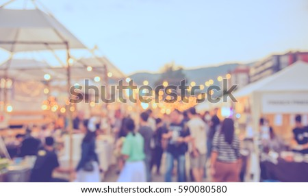 abstract blur image of food stall at day festival for background usage . (vintage tone) Royalty-Free Stock Photo #590080580