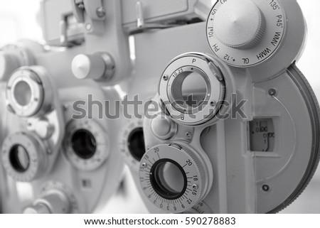 Phoropter, ophthalmic testing device machine,optometrist tool.Gray tone Royalty-Free Stock Photo #590278883