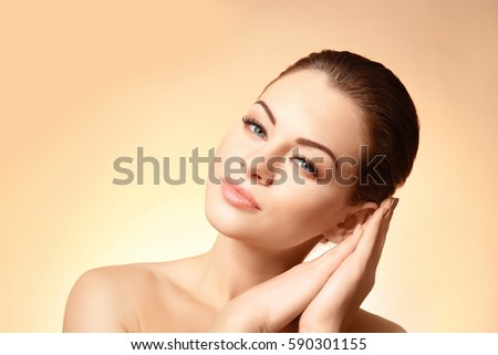 Portrait of beautiful young woman on color background #590301155