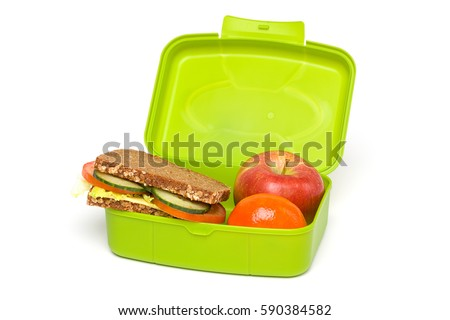 Healthy Green School Lunch Box, Isolated on White, with Whole-grain Bread and Fruit #590384582
