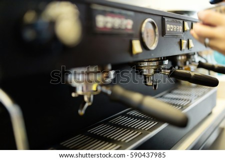 Professional barista making fresh coffee with machine #590437985