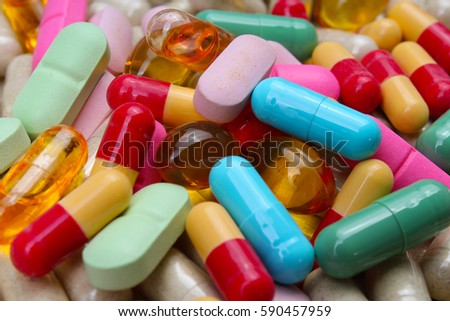 Medical or vitamin pills. Colorful medicine pills as texture. Pill pattern background.