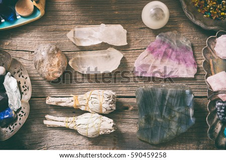 Natural gemstones, white sage and incense on wooden board #590459258