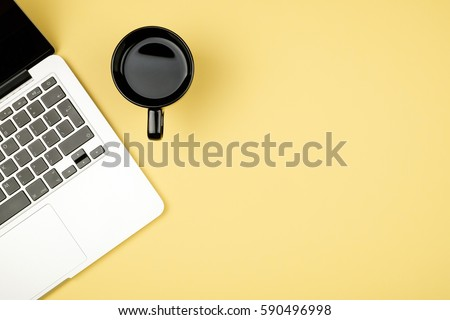 High angle view of office colored desk with copy space. Table with laptop and supplies. Top view. Flat lay. Freelancer or student desk